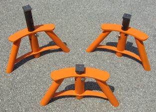 3 orange pallet supports